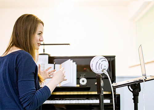 Lady teaching piano online